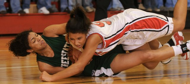 Lawrence High's Jasmyn turner (5) falls on top of Free State's Chantay Caron. The LHS girls topped Free State, 44-30.