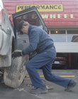 Gary Allan of Performance Tire and Wheel puts a tire on a customer's car. Motor vehicle maintenance is just one kind of preparation travelers should think of this winter. Break-ins and bursting pipes are also a concern.
