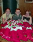 From left, Haleigh and J.D. Peel and Torrie Evans are stuffing stockings this year to send to U.S. troops in Iraq, including their father, Joe Peel.