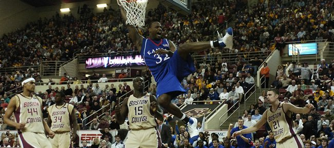 Kansas University forward Darnell Jackson swings off the rim after throwing down a dunk. Jackson scored a game-high 25 points in the Jayhawks' 85-60 victory over Boston College on Saturday in Boston.