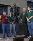 Three current Free State High basketball players are grandsons of members of the 1952 Kansas University basketball team that won the national championship and the Olympic gold medal. They are, from left, Bill Hougland and his grandson Matthew Ruder; Charlie Hoag and Chase Hoag; and Bill Lienhard and grandson Ryan Scott.