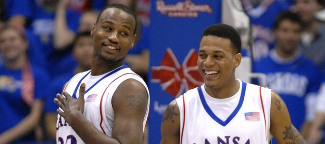 Kansas forward Darnell Jackson, left, and guard Brandon Rush laugh together during a timeout against Florida Atlantic. The Jayhawks will finish their nonconference slate tonight against Loyola (Md.).