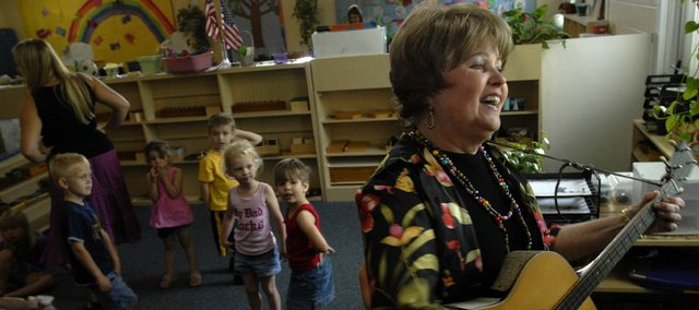 Susan Mozykowski leads a sing-a-long in June 2007 at Sunshine Acres Montessori Preschool and Daycare Center, the preschool she co-founded in 1970. Susan died Jan. 5, 2008, at her Lawrence home after an 18-month battle with brain cancer.