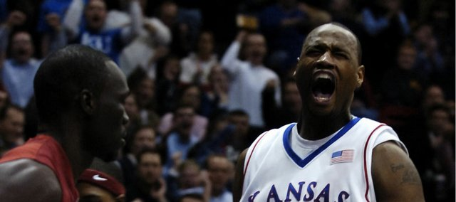 Kansas University forward Darnell Jackson roars after a dunk on the opening drive against Oklahoma. The slam set the tone for Jackson and the Jayhawks; he went on to lead KU with 17 points in an 85-55 blowout of the Sooners on Monday at Allen Fieldhouse. Jackson was officially traded to the Kings Wednesday.