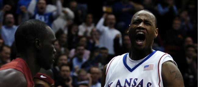 Kansas University forward Darnell Jackson roars after a dunk on the open