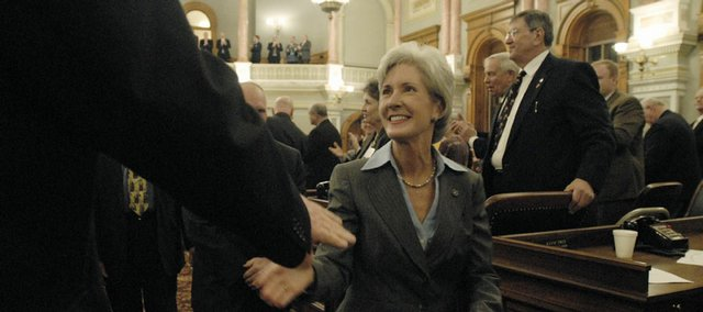 Gov. Kathleen Sebelius greets state representatives after delivering the 2008 State of the State address on Monday at the Kansas State Capitol in Topeka. During her speech, Sebelius challenged the Legislature to help her create a climate change action plan and said Kansas was poised to play a historic role in the nation's development of wind energy and alternative fuels.