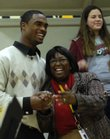 Kansas University football player Darrell Stuckey embraces South Junior High School teacher Betty Norwood on Friday during the school's annual Martin Luther King Jr. celebration. Stuckey spoke to the students about King's message.