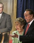 Former Senate Majority Leader Bob Dole, R-Kan., and his wife, Sen. Elizabeth Dole, R-N.C., appear at the unveiling of his portrait at the U.S. Capitol in July, 2006.