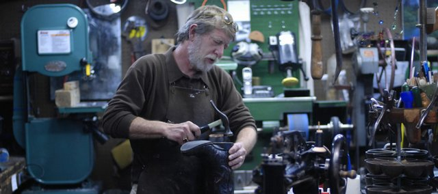Bruce Barlow, of BKB Leather, repairs a boot Wednesday in his shop, 811 Elm St. Barlow has worked with leather for 22 years. He now repairs boots, purses, belts and most any personal items made of leather.