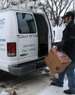 Alex Kaufman, of Community Wireless Communications, loads gear into a Lawrence Freenet truck outside the Lawrence Freenet offices, 4105 W. Sixth St, in this 2008 file photo.