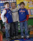 Celebrating their sixth birthday in their kindergarten class at Langston Hughes School on Wednesday are, background from left, Keaton Hoy, Ryan Lutz and Stephen Pendry. All three were born Jan. 30, 2002, the day an ice storm struck Lawrence. At left is classmate Avery Carroll.