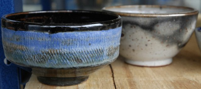 Bowls to be sold at the Souper Bowl cool Friday after being unloaded from the kiln at the Lawrence Arts Center, 940 N.H.