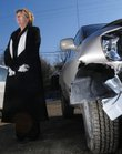 Lawrence resident Barbara Trouslot stands beside her Toyota Highlander Friday after the vehicle was carjacked from her and wrecked Thursday night. After being threatened by a carjacker, Trouslot tossed her keys outside before exiting the vehicle at the Dairy Queen at 1835 Mass., where she had stopped for ice cream. Edward James Wise, a Kansas City, Kan., transient, is suspected in the crime and was arrested downtown Thursday night after being tased.