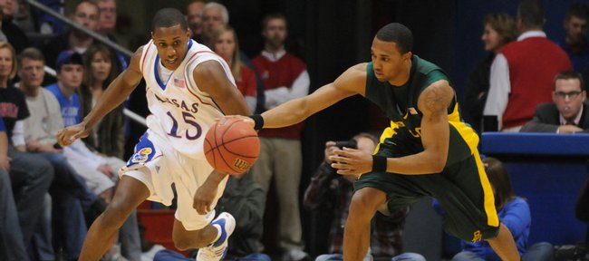 Kansas' Mario Chalmers and Baylor's Henry Dugat race for possession of the ball on Saturday at Allen Fieldhouse.