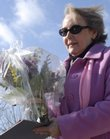 Carol Brown delivers flowers for the Habitat for Humanity Women Build Valentine's Day Fundraiser on Tuesday in Lawrence. Brown is the recipient of a house that will be built with the help of money through the fundraiser.