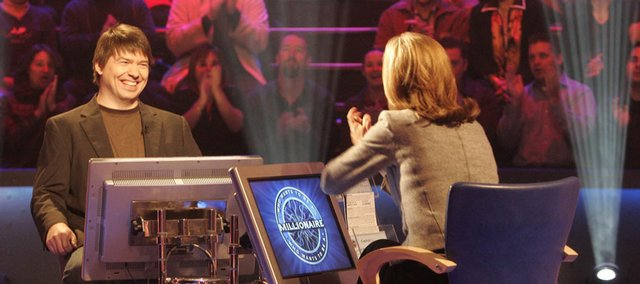 "Eric Melin, left, a Lawrence resident and Kansas University graduate in film, chats with host Meredith Vieira on the set of ""Who Wants to Be a Millionaire."" Melin, a film critic, will appear on Monday and Tuesday during the quiz show's movie week."