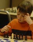 Sam Hambleton, 9, ponders how to proceed Saturday during the Cordley Elementary Chess Tournament at Kansas University's Kansas Union.