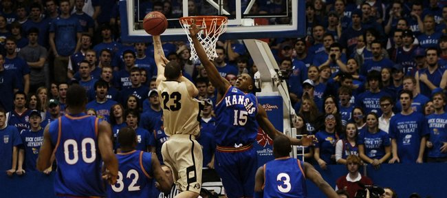 Kansas guard Mario Chalmers (15) gets up to put a hand on a shot by Colorado guard Richard Roby (23) during the first half of the Jayhawks' 69-45 victory. Chalmers led the Jayhawks with 13 points, while Roby - the Buffs' leading scorer on the season - was held to two points Saturday in Allen Fieldhouse.
