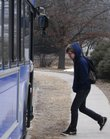 Joe Fitzsimmons climbs aboard a Johnson County Transit K-10 Connector bus last week at the intersection of 19th Street and Naismith Drive. Ridership on the bus service between Lawrence and Johnson County set records in January and February.