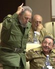 Cuba's President Fidel Castro, left, votes in favor to the modification on the Cuban Constitution, as his brother, Defense Minister Raul Castro, looks at him during an extraordinary National Assembly session in Havana, in this June 26, 2002 file photo. Ailing leader Fidel Castro resigned as Cuba's president early Tuesday Feb. 19, 2008, after nearly a half-century in power, saying he will not accept a new term when the newly elected parliament meets on Sunday.