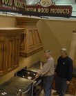 Dealers set up Thursday for this weekend's Lawrence Home Show at First Serve Tennis Center, 5200 Clinton Parkway. John Mitchell, left, of Custom Wood Products of St. Marys, and Mike Lorey, right, a cabinet dealer from St. Joseph, Mo., were putting together Mitchell's booth in preparation for the event put on by Lawrence Home Builders Association.