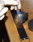 Ninth-grader Lacy Sheley dusts for fingerprints.