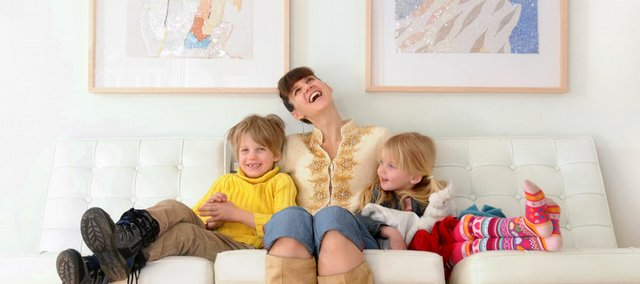 Lawrence artist Kristin Morland has a laugh with her son, Henry, 6, and daughter, Rose, 4, as the three sit for a portrait Wednesday in their Lawrence home. The Kansas University graduate takes care of her children at home and creates art as well.