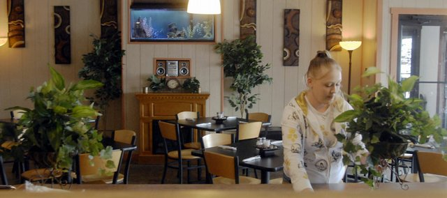Waitress Melissa Olson,19, Lawrence, cleans up at Midwest Fish Frye & So Much More, 1910 Haskell Ave. Anthony Gauna, owner of Cross Town Tavern, bought the restaurant and now offers a wider variety of food. Still, fish is served for customers observing Lent.