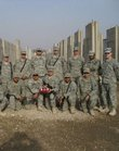 The U.S. Army platoon led by 1st Lt. Matthew Nicholl, a Kansas University graduate, at far right, received a football signed by the Free State High School football team as part of a care package from the school. The platoon in the 3rd Infantry Division is deployed to Baghdad until the end of July.
