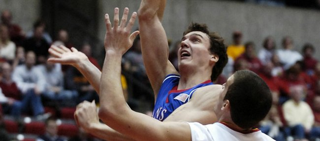 Kansas center Sasha Kaun muscles in a bucket over Iowa State defenders Alex Thompson and Jiri Hubalek during the first half Wednesday, Feb. 27, 2008 at Hilton Coliseum in Ames, Iowa. Left is Kansas forward Darrell Arthur.