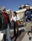 Members of the Pewtress family stroll through the Legends shopping area Wednesday in Wyandotte County. From left are Betty Pewtress, Charlotte, N.C., her daughter-in-law, Carmen, and her son, Rob Pewtress, with their 17-day-old son, Alexander, from Kansas City, Kan. The family is formerly of Lawrence. A new report indicates that Lawrence is losing shopping dollars to the Legends and Village West in Wyandotte County.