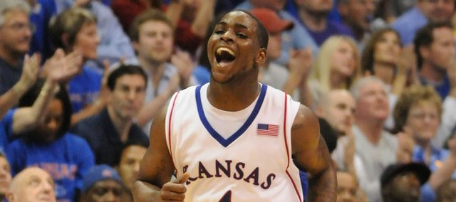 Kansas University guard Sherron Collins trots back on defense with a wide smile after drilling a three-pointer in the Jayhawks' 88-74 victory over Kansas State. Collins hit three of seven treys - and KU 11 of 23 - in the victory Saturday in Allen Fieldhouse.