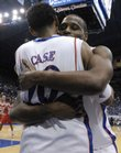 Kansas' Darnell Jackson gives his fellow senior teammate Jeremy Case a bear hug on the sidelines during the Texas Tech blowout on Monday at Allen Fieldhouse. The Jayhawks shredded the Red Raiders, 109-51.