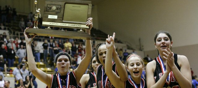 Lawrence High's girls basketball players, including, from left, Lindsey Murray, Danielle Bird, Tania Jackson, Cassie Potter and Shelby Miller, celebrate their Class 6A state championship. The Lions beat Goddard, 54-52, on Saturday in Emporia.