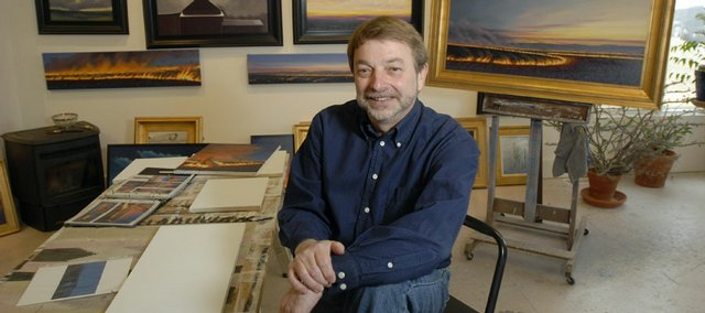 Painter Louis Copt has finished a documentary about the grass cycles of the Flint Hills, focusing on the burning. He is pictured Wednesday in his studio Northwest of Lawrence.