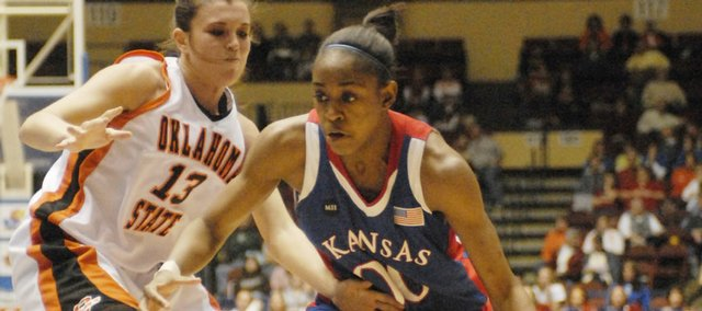 Kansas' LaChelda Jacobs, right, drives on OSU's Taylor Hardeman. Jacobs had 15 points in the Jayhawks' 82-62 loss Wednesday in Kansas City, Mo.