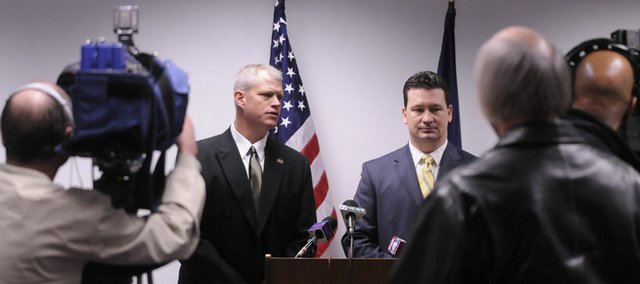 "Sheriff Ken McGovern, left, and Douglas County District Attorney Charles Branson announce charges filed against two men, Major C. Edwards, 28, Lawrence, and  Durell A. Jones, 23, Kansas City, Kan., with first degree murder for the shooting death of Anthony ""Clacc"" Vital.  Vital, a local hip-hop artist, was shot multiple times and his body was found in October 2006 on a private drive west of Lawrence.  Both Edwards and Jones are currently are in federal custody."
