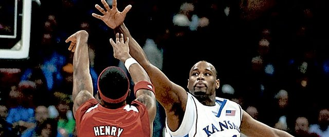Kansas forward Darnell Jackson defends against a shot by Nebraska guard Sek Henry during the second half Friday, March 14, 2008 at the Sprint Center in Kansas City, Mo.