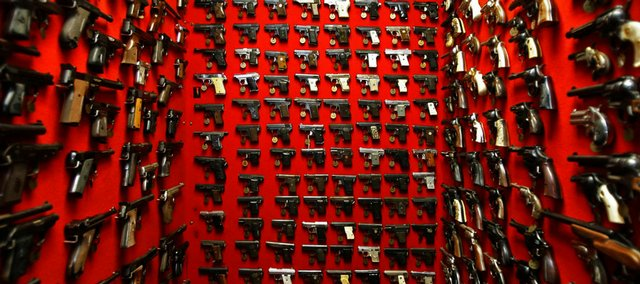 Guns line the walls of the firearms reference collection at the Washington Metropolitan Police Department headquarters in Washington, D.C., in this Sept. 28, 2007, file photo. Most of the guns, used now for police research, were seized from crimes under a 31-year-old law in the nation's capital that bars handgun ownership for nearly everyone except law enforcement. The ban is up for review in the Supreme Court.
