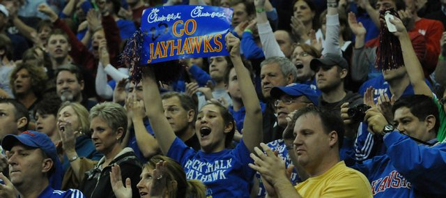 Kansas fans go wild in the stands as the Jayhawks begin to pull away from the Longhorns in the second half Sunday at the Sprint Center in Kansas City, Mo. After the Kansas University men's basketball team defeated the University of Texas, 84-74, and claimed the Big 12 Conference championship, it was named the No. 1 seed in the NCAA's Midwest Region. With the Jayhawks kicking off play in the tournament at 11:25 a.m. Thursday in Omaha, many fans are expected to follow, even though the Qwest Center is sold out for the game.