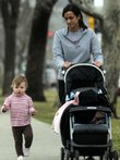 Maggie Mulhern, 17 months, jogs along next to her baby sitter, Michelle Walter, a Kansas University senior from Overland Park, as the two pass through South Park on a morning walk Tuesday. Lawrence was ranked the most walkable city in the state and the 38th most walkable city in the U.S. by Prevention magazine and the American Podiatric Medical Association.