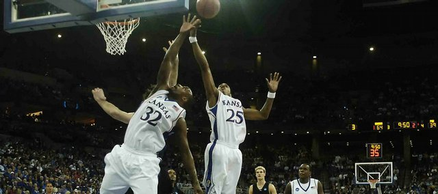 Kansas defenders Darnell Jackson, left, and Brandon Rush crash the boards for a rebound during the second half Thursday, March 20, 2008 at the Qwest Center in Omaha, Nebraska.