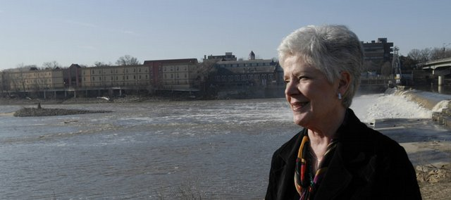 Kansas Insurance commissioner Sandy Praeger expects some areas of the state may be susceptible to flooding because of the wet winter and the already saturated ground. Praeger was photographed on the Kansas River levee in North Lawrence near the dam.