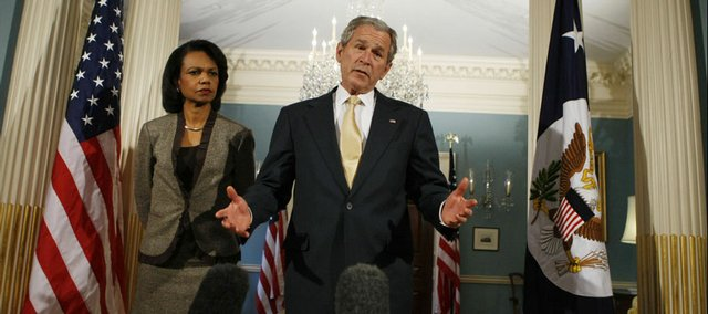 President Bush, accompanied by Secretary of State Condoleezza Rice, makes a statement at the State Department in Washington. Bush on Monday offered his sympathies to the families of the 4,000 military personnel killed in Iraq.