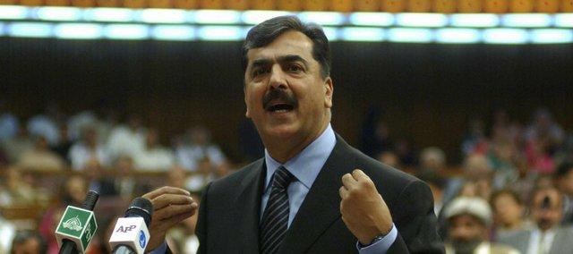 Pakistan's newly elected Prime Minister Yousaf Raza Gilani addresses the parliament in Islamabad, Pakistan. The longtime loyalist of slain opposition leader Benazir Bhutto was elected Monday, and he immediately freed judges detained last fall by President Pervez Musharraf.