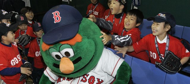 Children wearing Boston Red Sox T-shirts clown around with the team's mascot in the dugout before a baseball clinic at Tokyo Dome on Monday in Tokyo, Japan. Boston will meet Oakland in Major League Baseball's regular-season opener today in Japan.