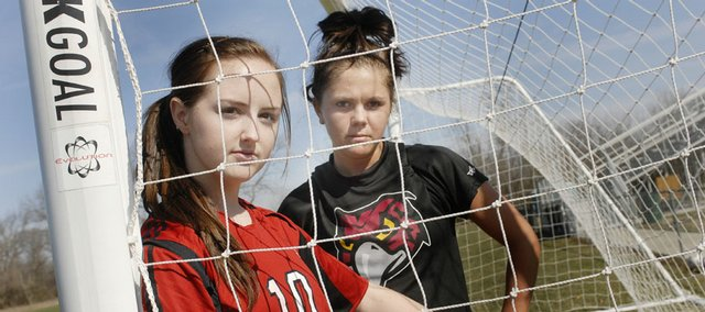 Seniors Madison Bertrand, of Lawrence High, left, and Leah Williams, of Free State, will lead the local girls soccer teams onto the field today for the 2008 season openers.