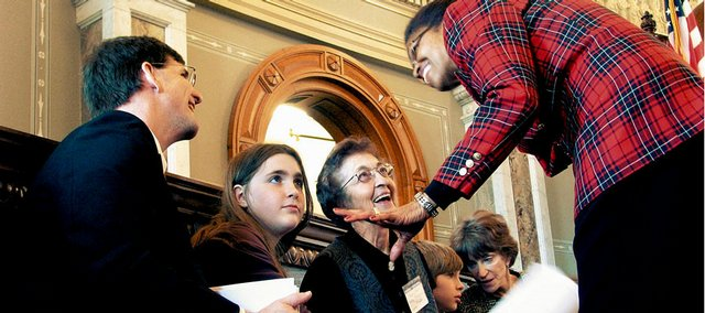 State Rep. Barbara Ballard, D-Lawrence, right, speaks with family members of the late John J. Conard Sr. on Tuesday, when the Kansas Legislature approved a resolution honoring the former House speaker. From left are John Conard Jr., Conard's son; granddaughter Katie, 13; Virginia Conard, his widow; and grandson Spencer, 10. John Conard Sr., of Lawrence, died Oct. 12, 2007.