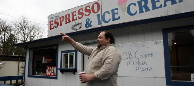 Jim Ford, owner of Amboy Espresso & Ice Cream points in the direction where a parachute was found in Amboy, Wash. The FBI is analyzing a torn, tangled parachute found in southwest Washington to determine whether it belongs to famed plane hijacker D.B. Cooper, who disappeared in 1971.