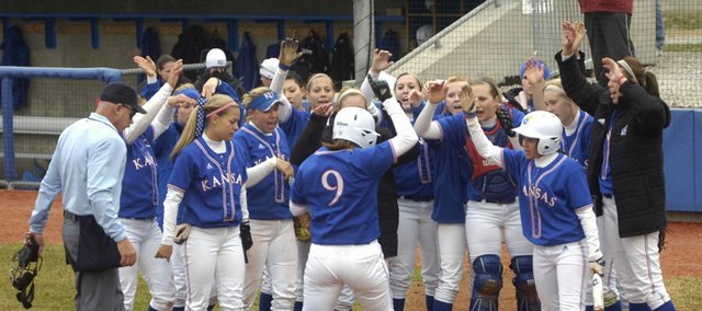 KU's softball team welcomes Liz Kocon at home plate after her home run against Missouri State. KU swept a doubleheader Wednesday at Arrocha Ballpark.